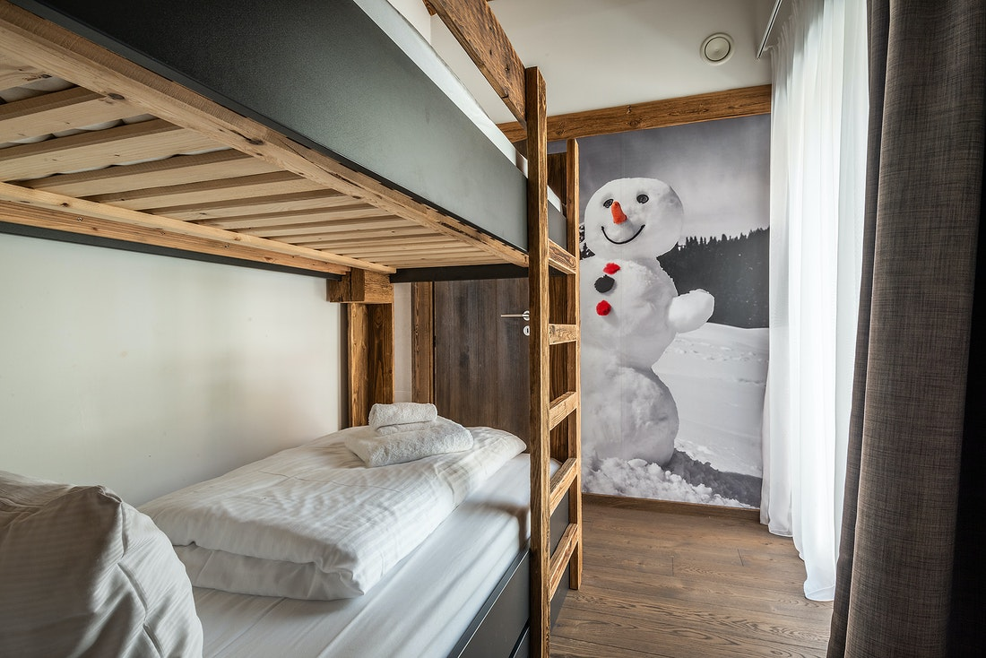 Wooden bunk beds at Le Rouge luxury chalet in Morzine
