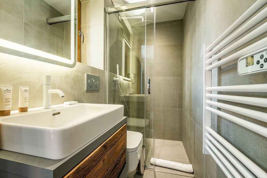 Modern ensuite with Nuxe toiletries at Herzog luxury chalet in Chamonix