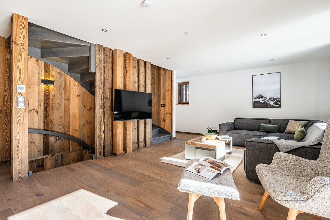 Living room with wooden walls and TV at Badi luxury chalet in Chamonix