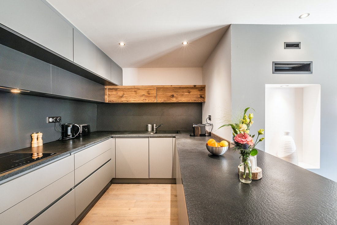 Modern black and wooden kitchen at Ruby luxury accommodation in Chamonix