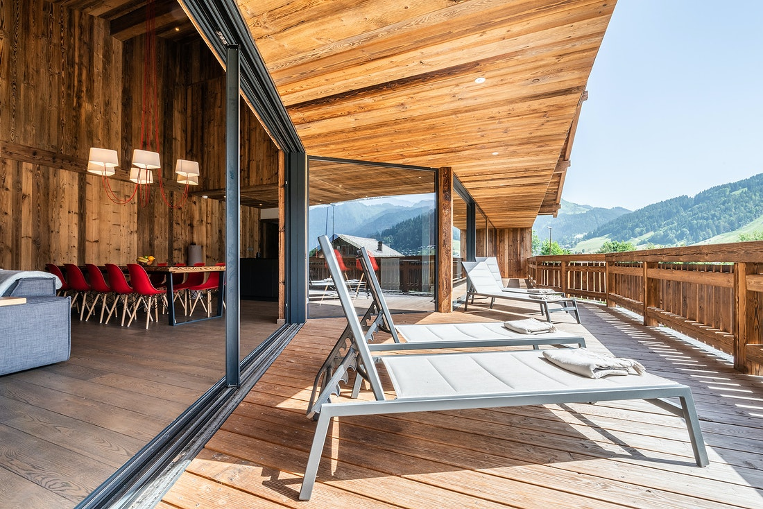 Terrace with mountain view at Le Rouge luxury chalet in Morzine