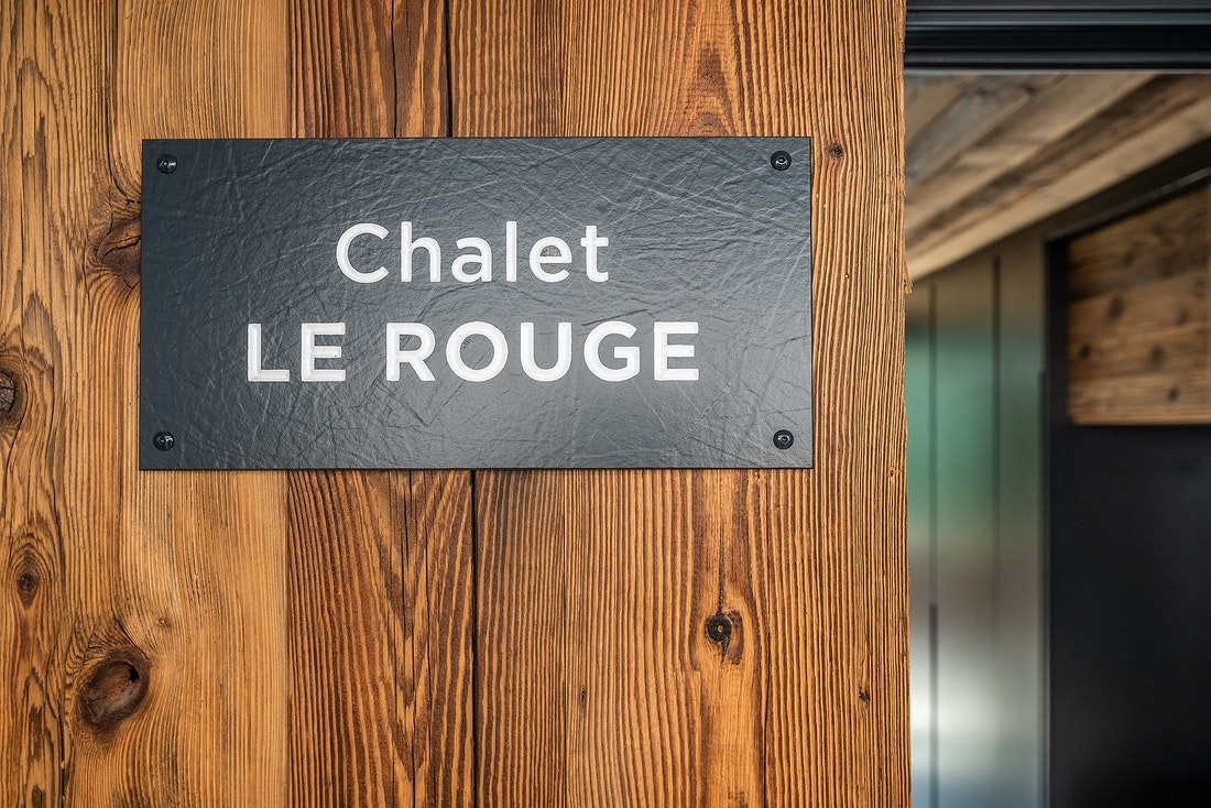 Black leather tag of Le Rouge luxury chalet in Morzine