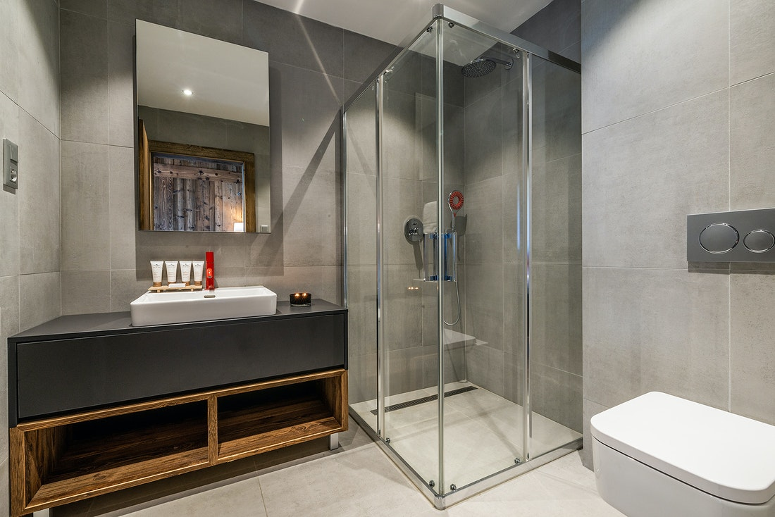 Modern bathroom with shower and Nuxe toiletries at Le Rouge luxury chalet in Morzine