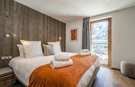 Double bedroom with premium mattress at Ravanel luxury accommodation in Chamonix