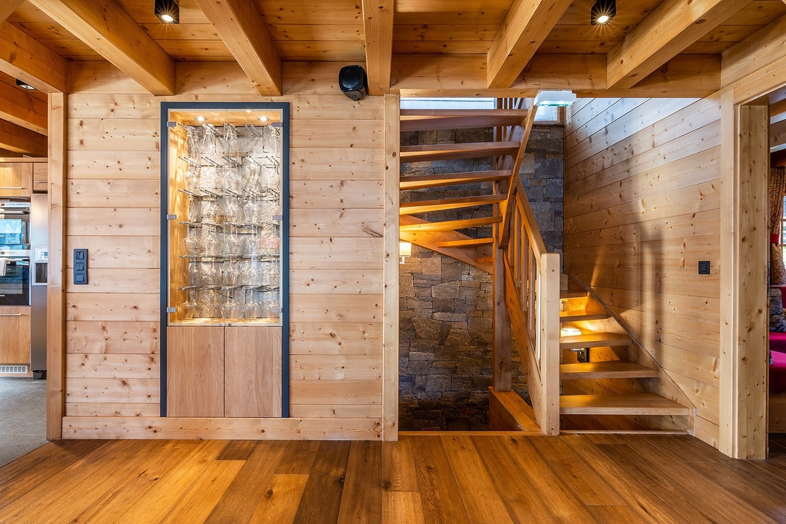Wine glass holder and wooden staircase of Abachi luxury chalet in Les Gets