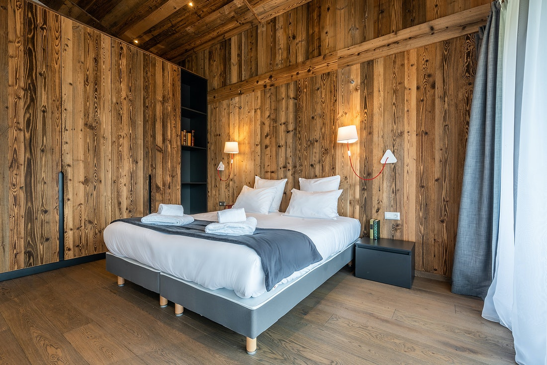 Master bedroom at Le Rouge luxury chalet in Morzine