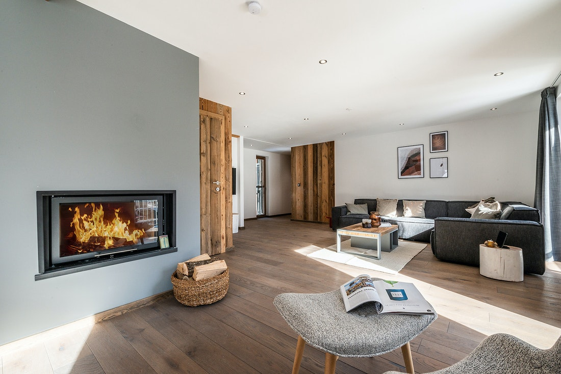 Living room with fireplace at Ruby luxury accommodation in Chamonix