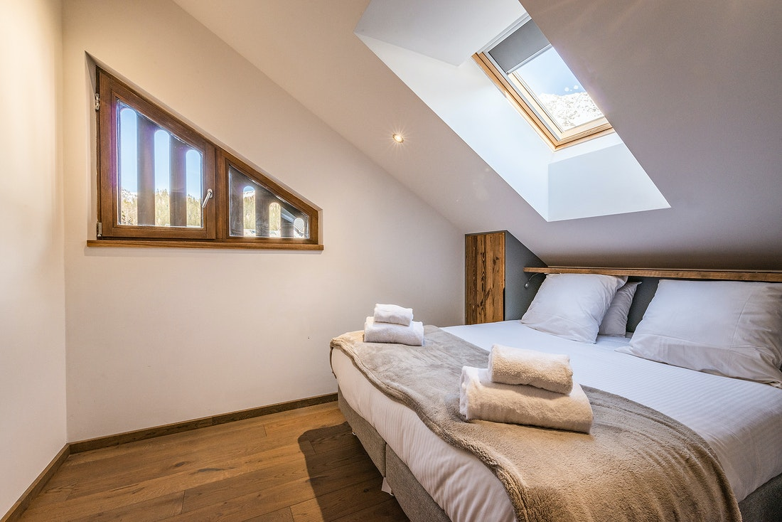 Double bedroom with premium mattress at Douka accommodation in Morzine