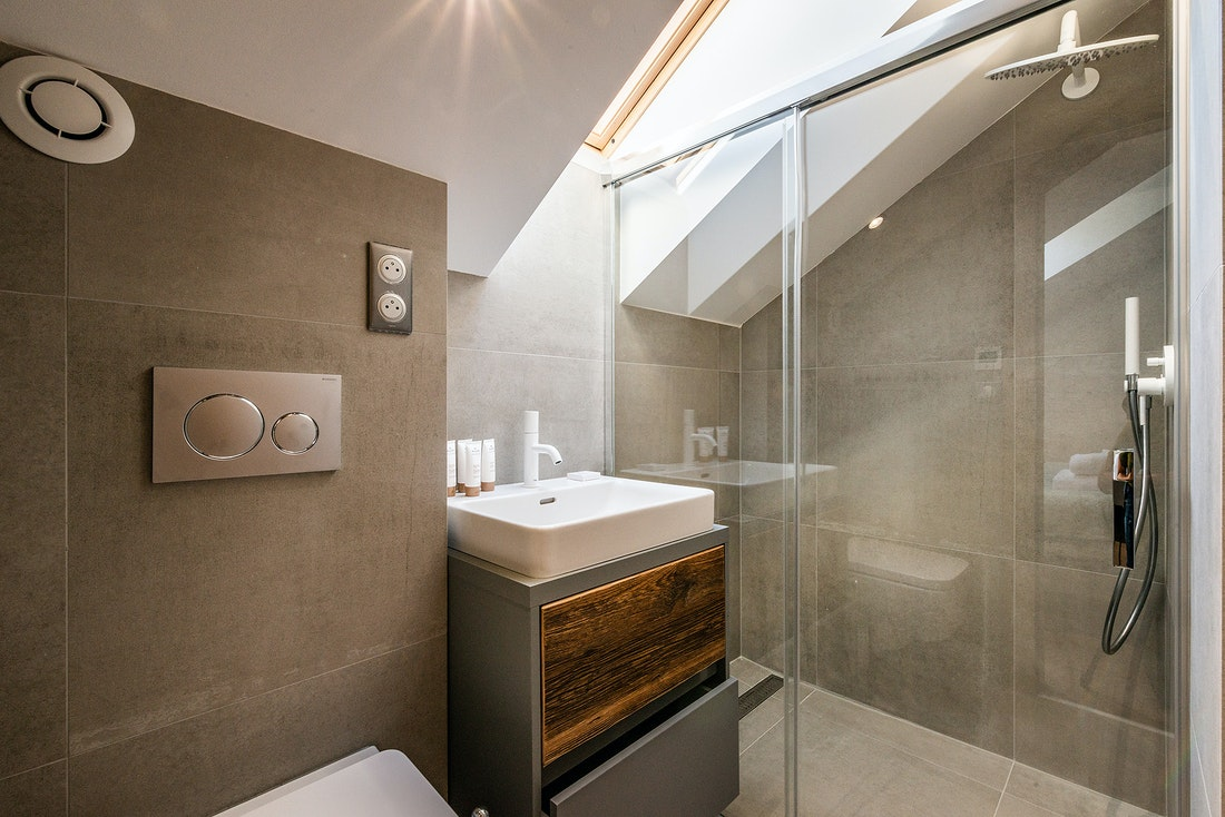 Modern bathroom with shower at Douka accommodation in Morzine
