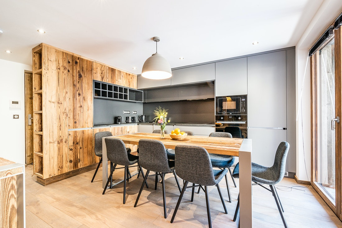Fully-equipped kitchen with wooden panels at Herzog luxury chalet in Chamonix