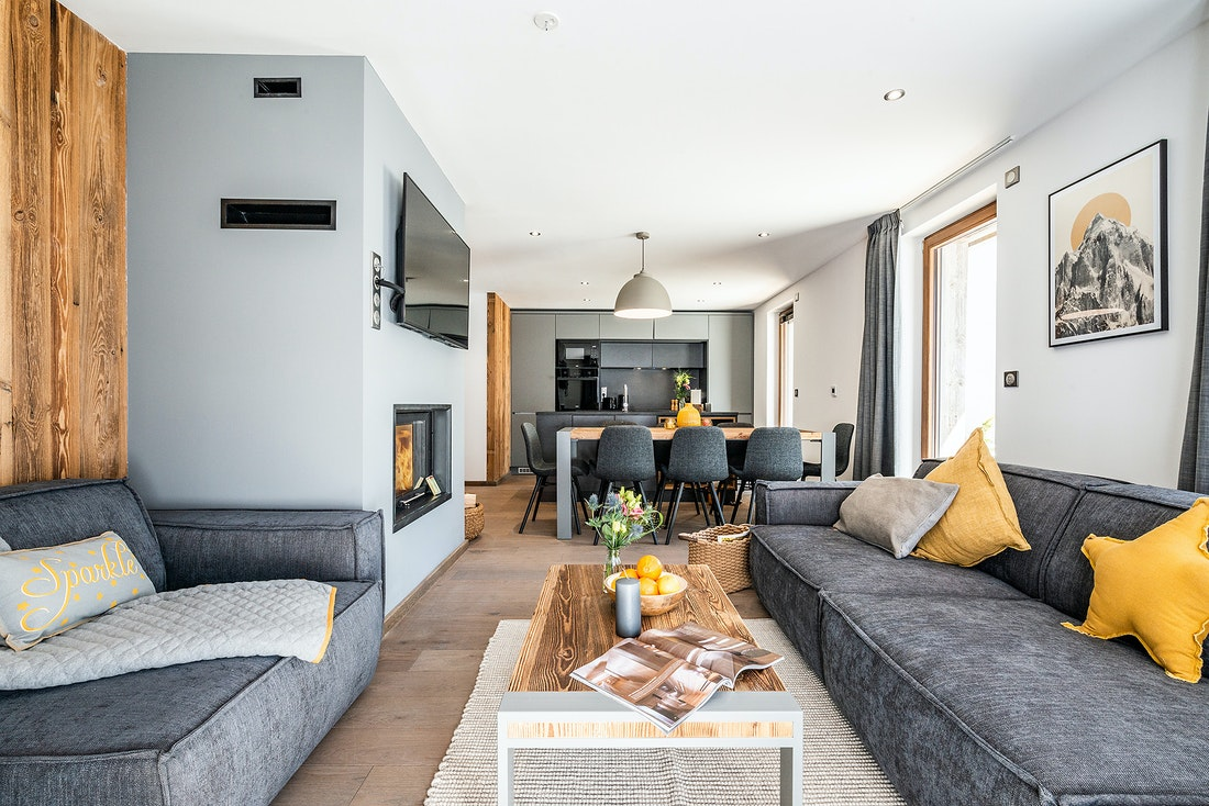 Modern living room with TV at Eyong accommodation in Chamonix