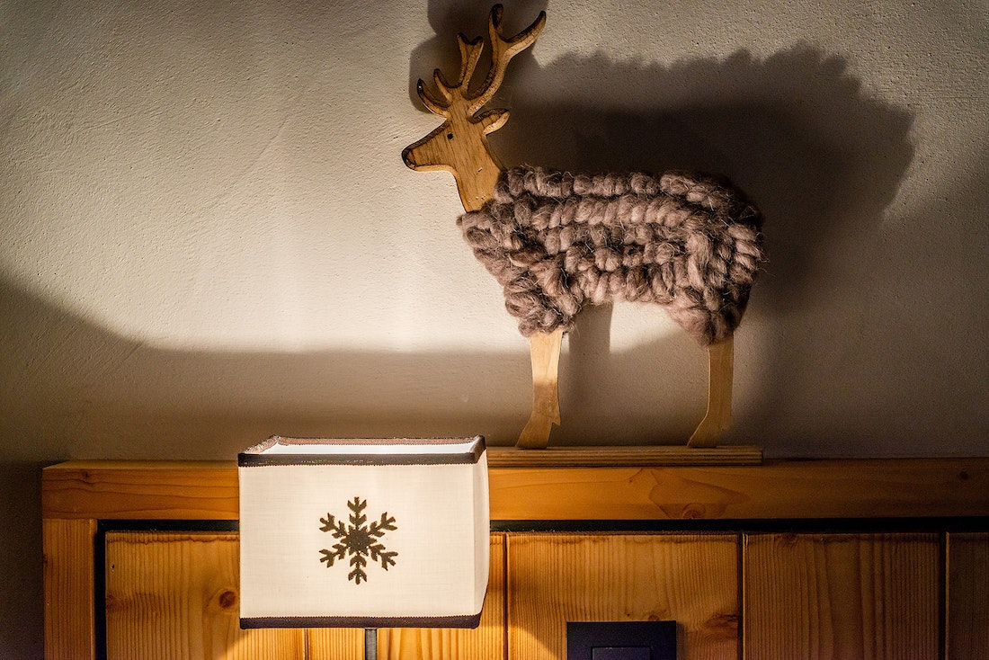 Knitted reindeer in the bedroom of Abachi luxury chalet in Les Gets