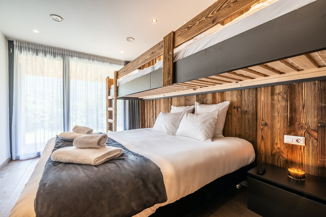 Double bedroom with bunkbed at Le Rouge luxury chalet in Morzine