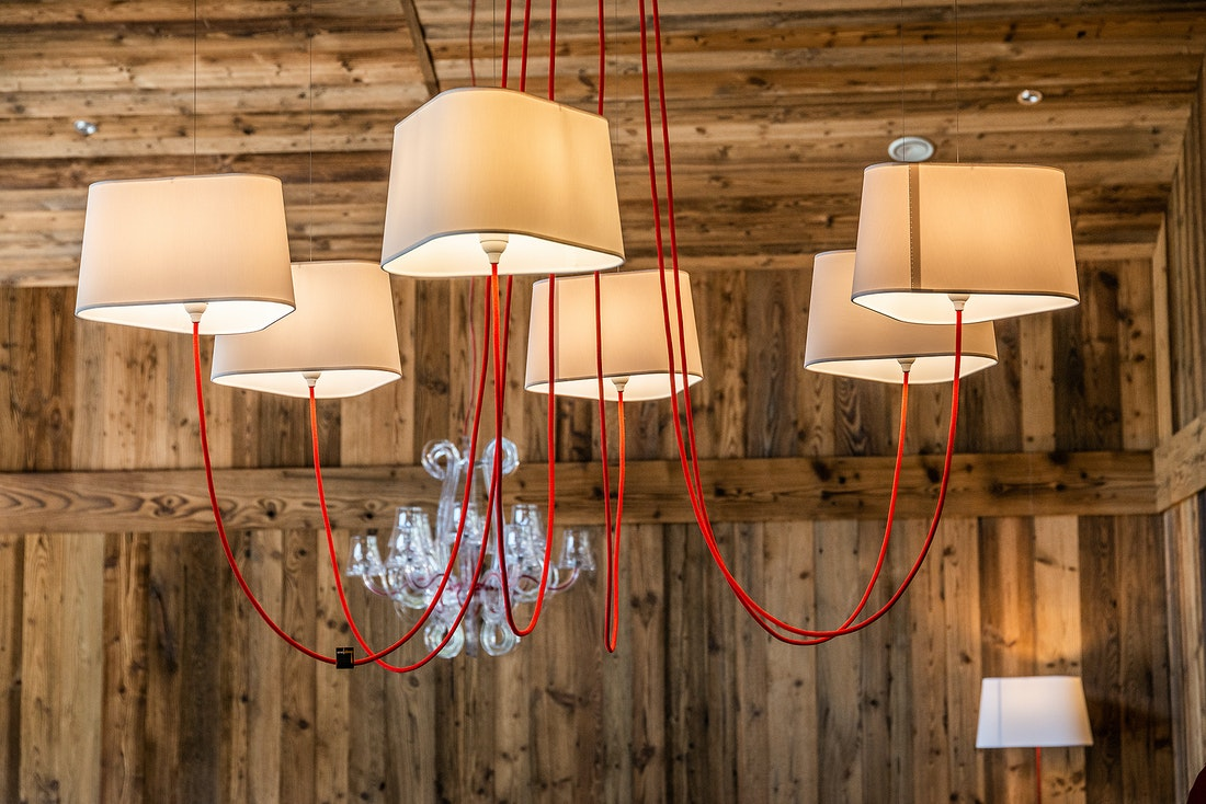 White and red chandelier of Le Rouge luxury chalet in Morzine