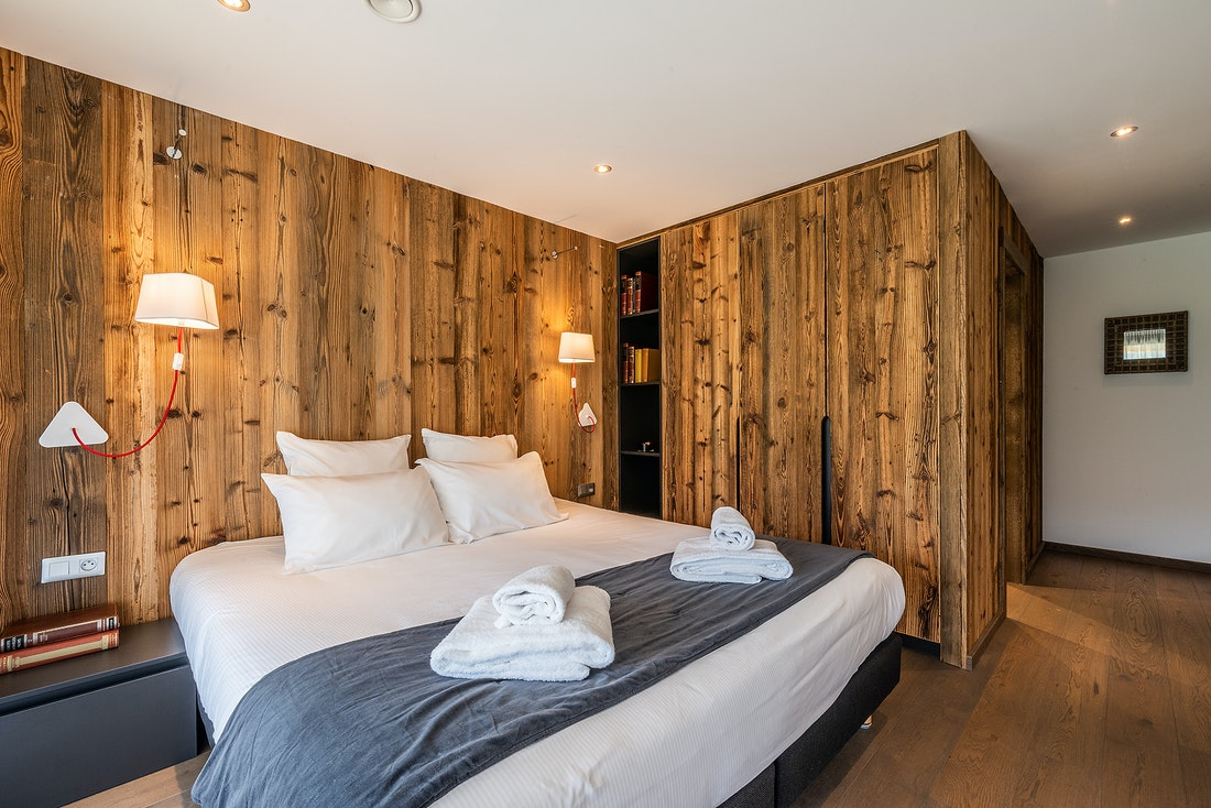 Double bedroom with large windows at at Le Rouge luxury chalet in Morzine