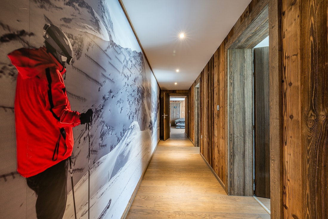 Wooden corridor with mountains photography at Le Rouge luxury chalet in Morzine