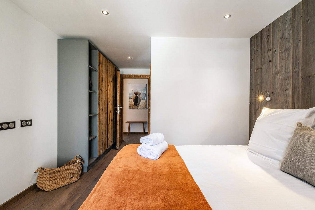 Double bedroom ensuite with wooden storage at Ravanel luxury accommodation in Chamonix
