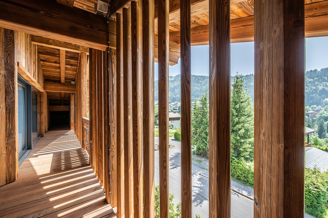 Outside wooden corridor at Le Rouge luxury chalet in Morzine