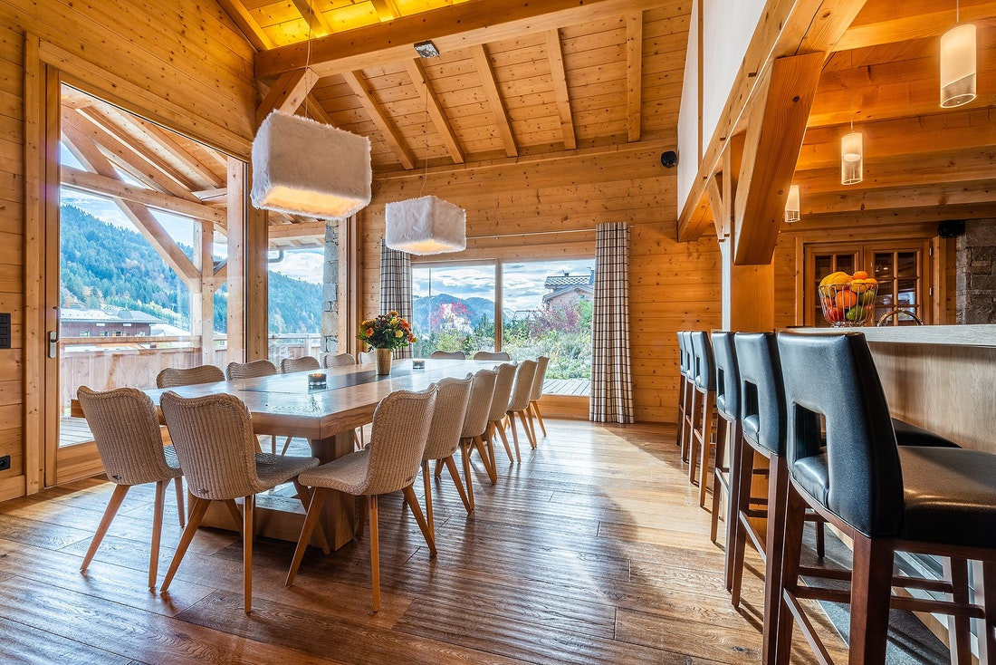 Large dining table in the living room of Abachi luxury chalet in Les Gets
