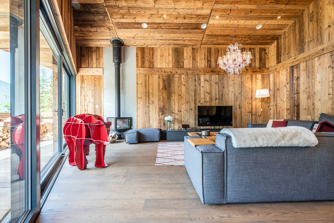 Designer living room of Le Rouge luxury chalet in Morzine featuring an artwork by iBride