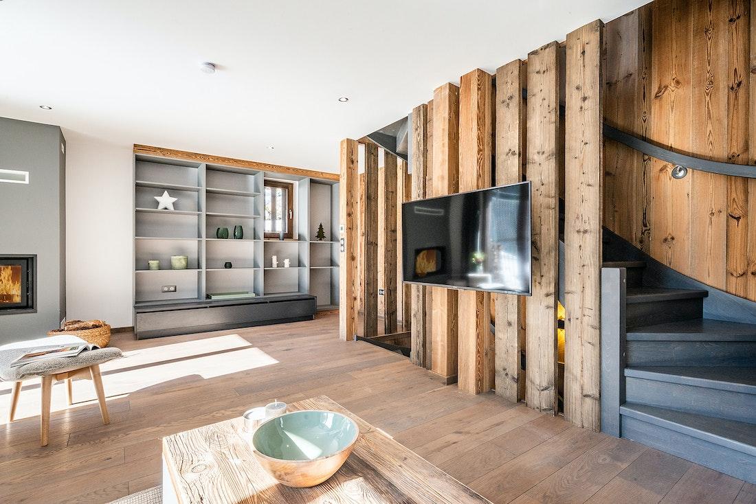 Modern living room with TV at Badi luxury chalet in Chamonix