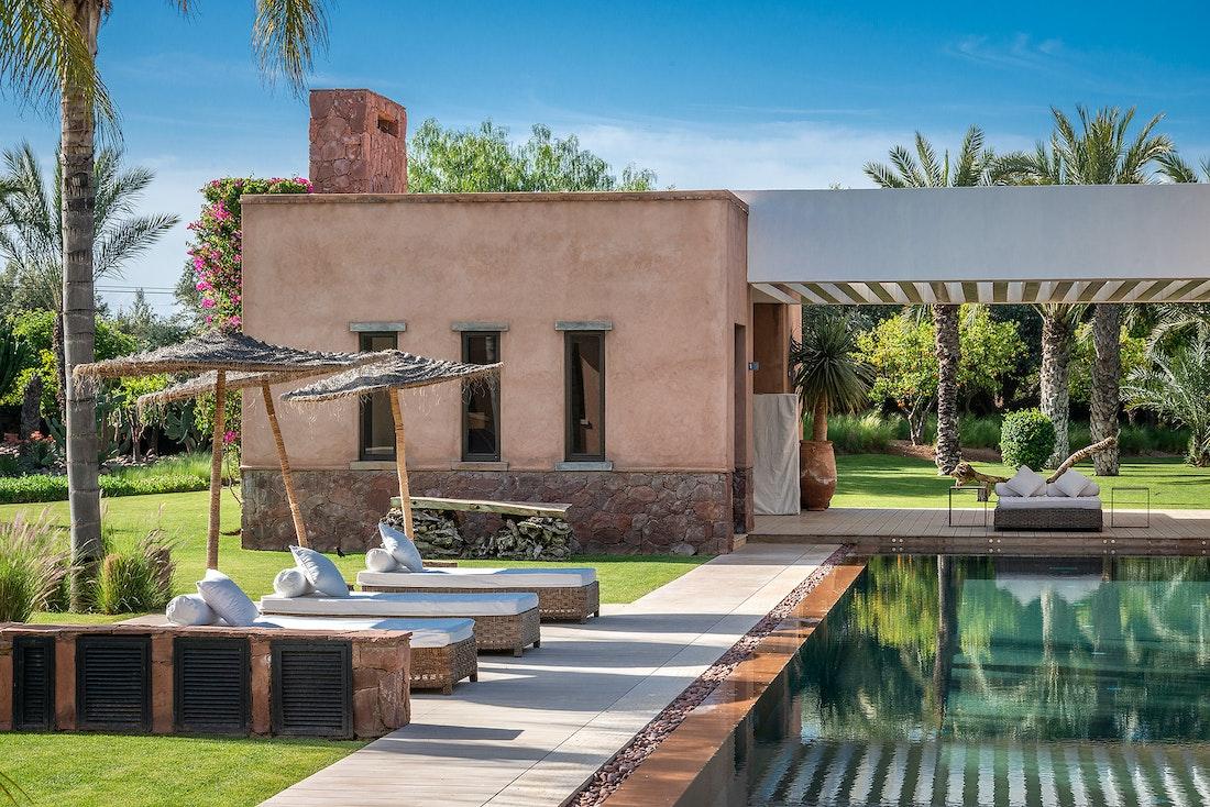 Private pool with raffia sunbeds at Zagora private villa in Marrakech