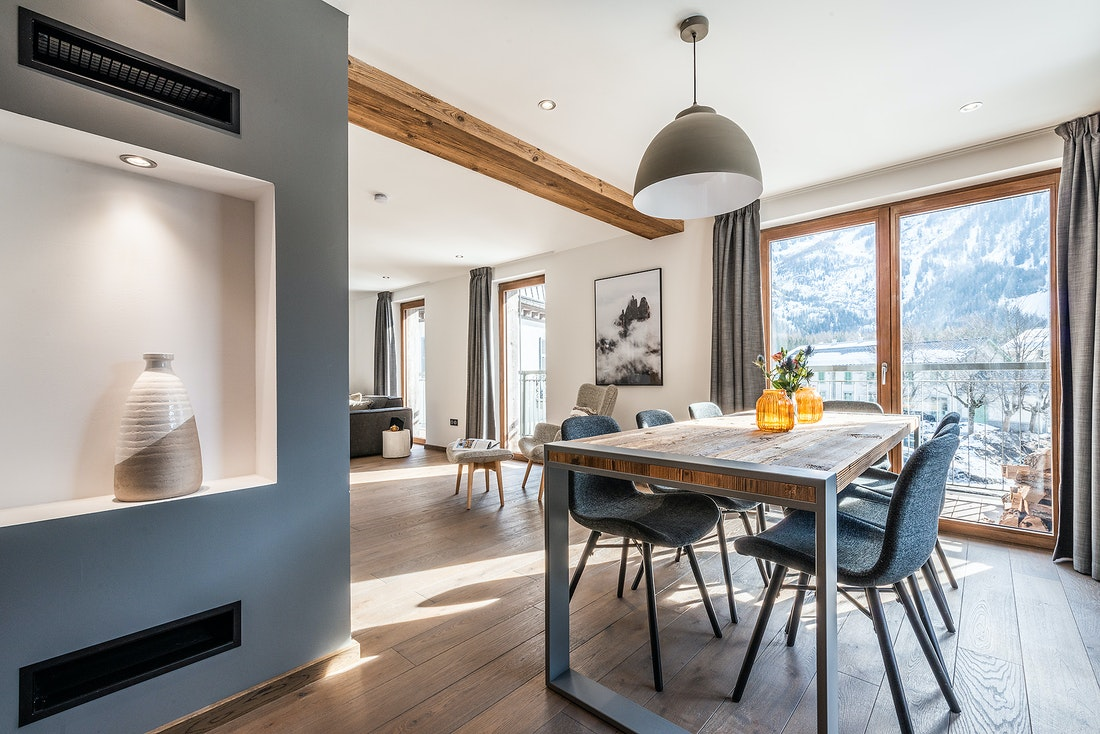 Dining room with dark grey wall at Ruby luxury accommodation in Chamonix
