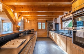 Fully-equipped kitchen of Abachi luxury chalet in Les Gets