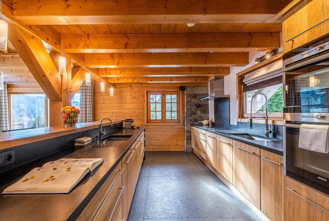 Comtemporary fully equipped kitchen luxury hotel services chalet Abachi Les Gets