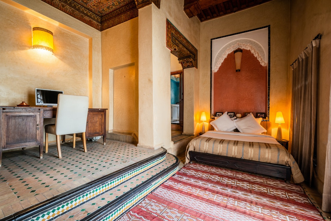Double en-suite with colourful moroccan tiles flooring at Adilah riad in Marrakech