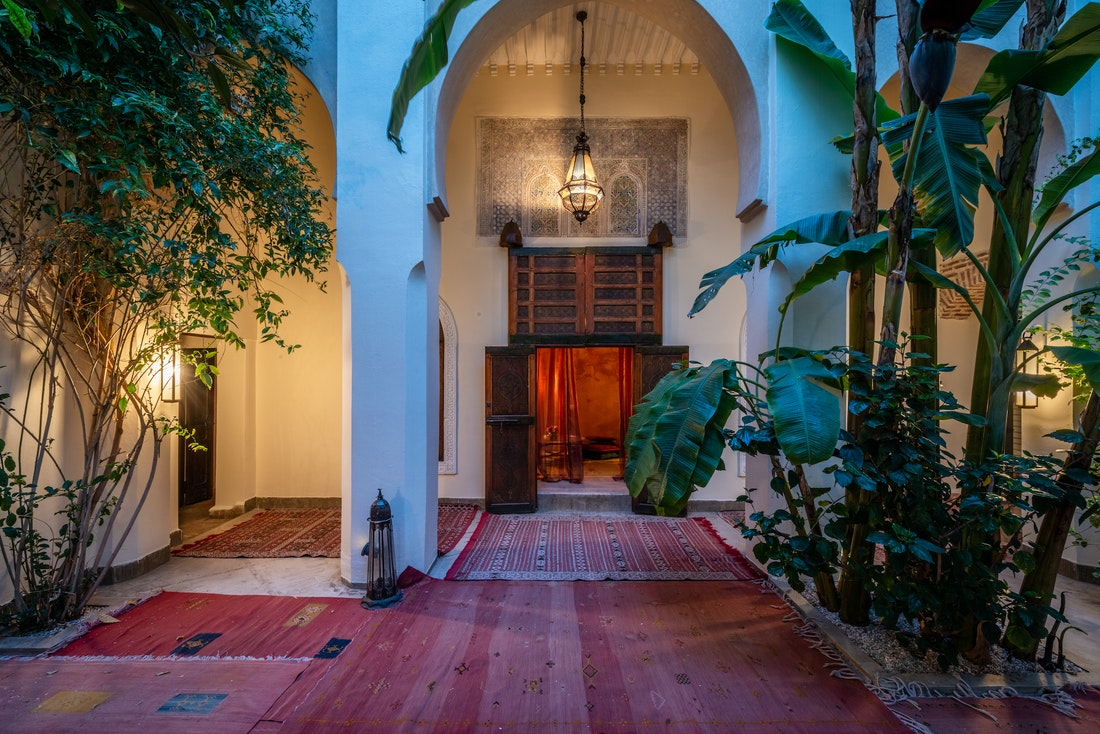 Patio with red berber rugs at Adilah riad in Marrakech