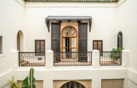 Traditional wooden black and brown Moroccan door at Adilah riad in Marrakech