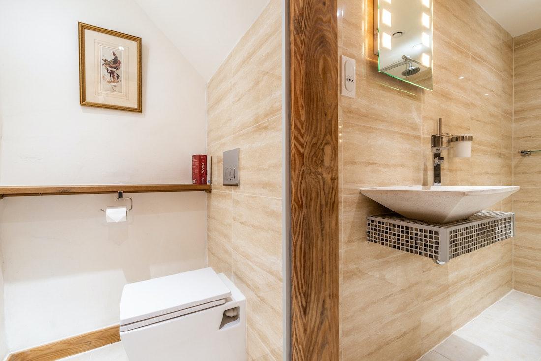 Modern bathroom with toilet at La Ferme de Margot luxury chalet in Morzine