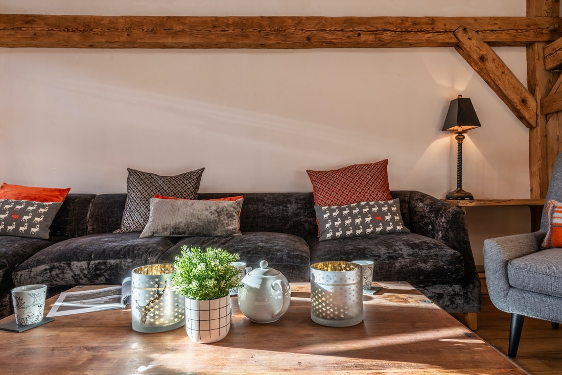 Living room with a wooden coffee table at La Ferme de Margot luxury chalet in Morzine