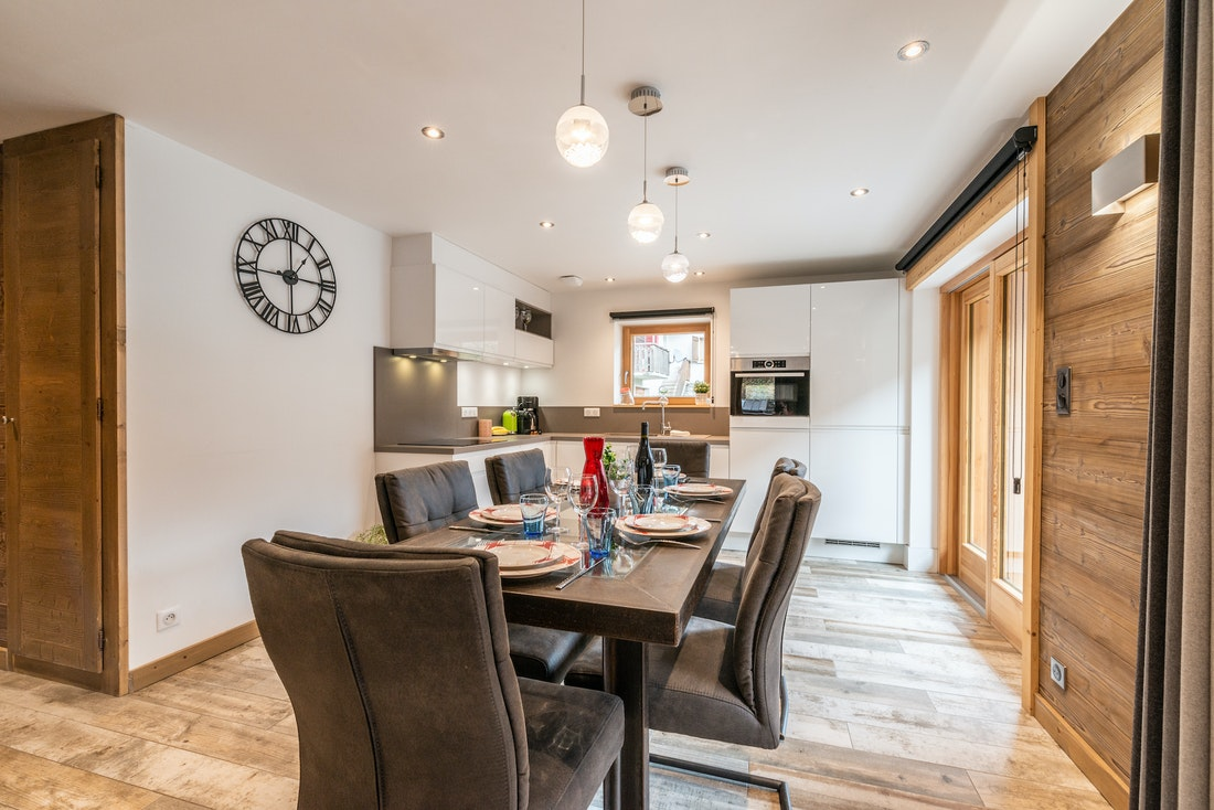 Modern dining room and living room at Flocon accommodation in Morzine