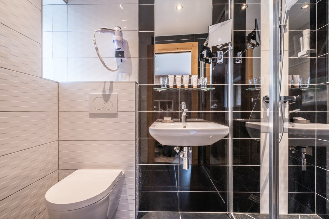 Black and white modern bathroom at Ourson accommodation in Morzine