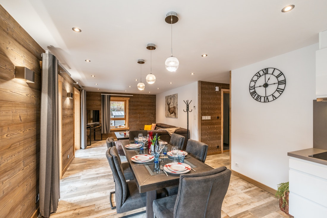 Modern dining room and living room with TV at Ourson accommodation in Morzine