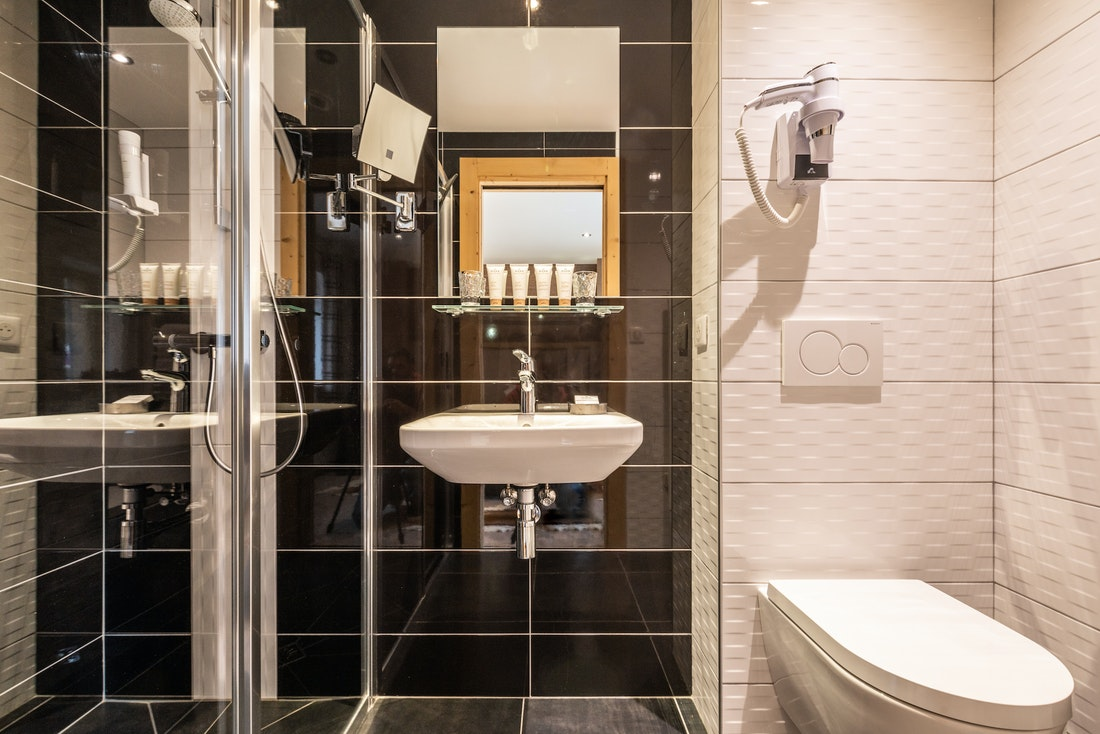 Black and white modern bathroom with shower at Flocon accommodation in Morzine