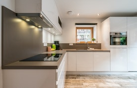 Modern black and white fully-equipped kitchen at Ourson accommodation in Morzine