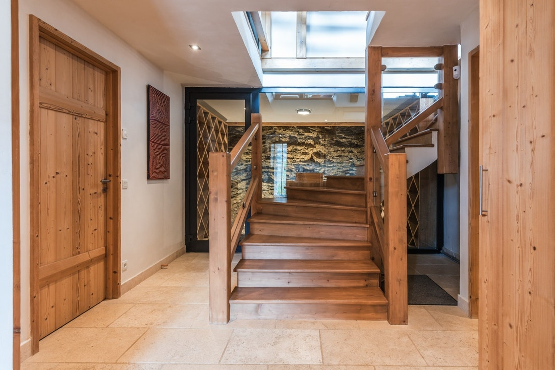 Wooden staircase at Omaroo I luxury chalet in Morzine
