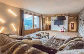 TV room with furry blankets at Omaroo I luxury chalet in Morzine