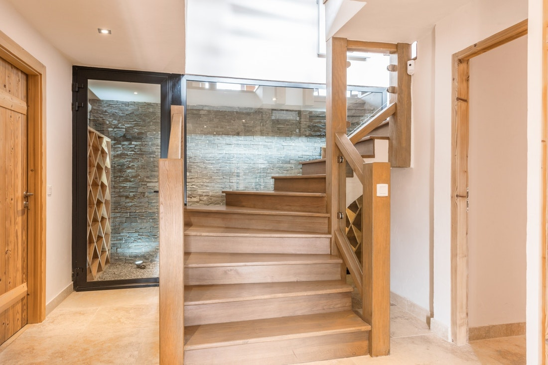 Wooden staircase eco-friendly chalet Omaroo II Morzine