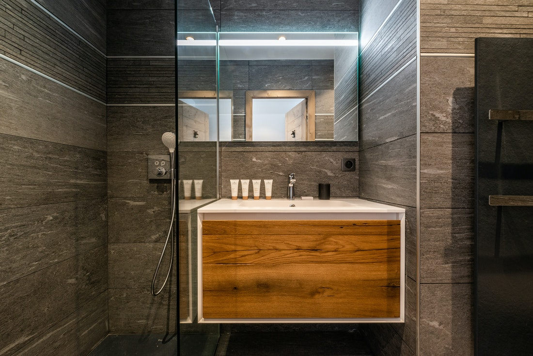 Modern bathroom with light grey italian shower at Ozigo accommodation in Les Gets