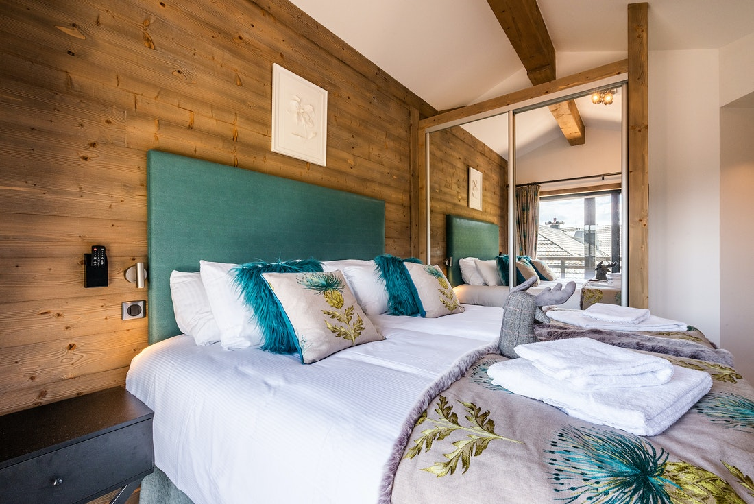 Ensuite Bedroom with wooden walls at Ozigo accommodation in Les Gets