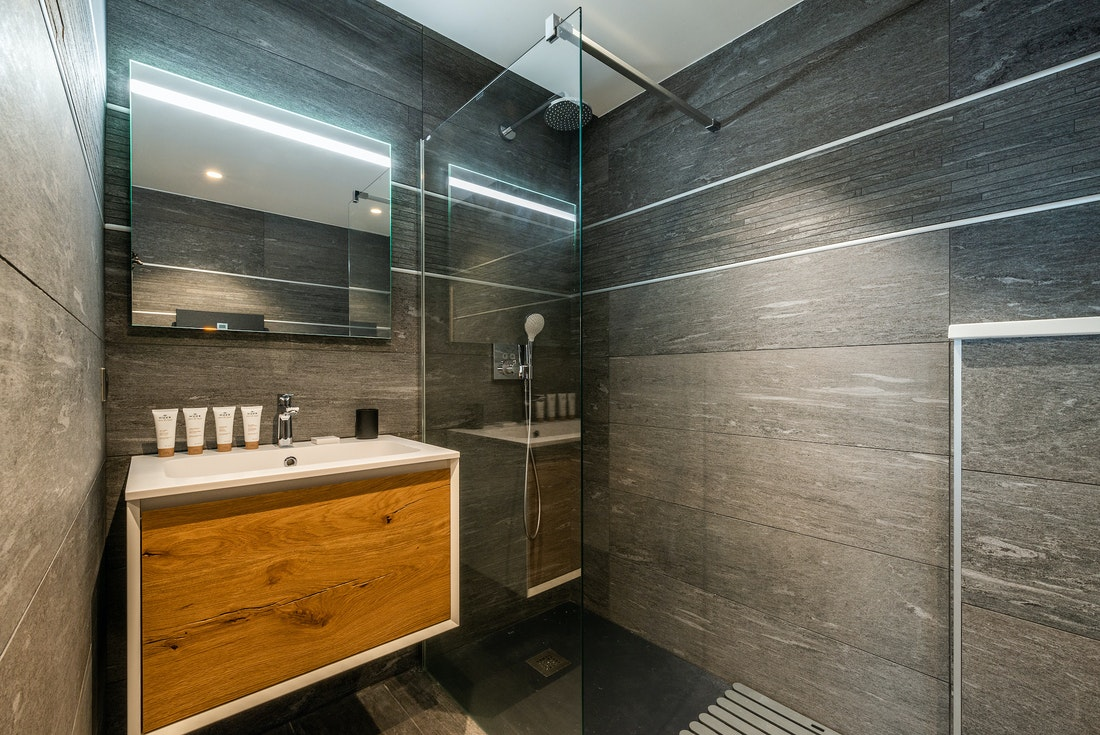Italian shower with wooden sink at Ozigo accommodation in Les Gets