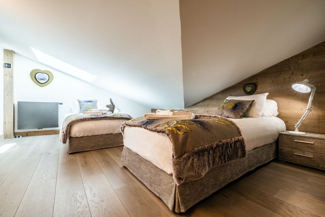 Bedroom with single bed and ceiling window at Ozigo accommodation in Les Gets