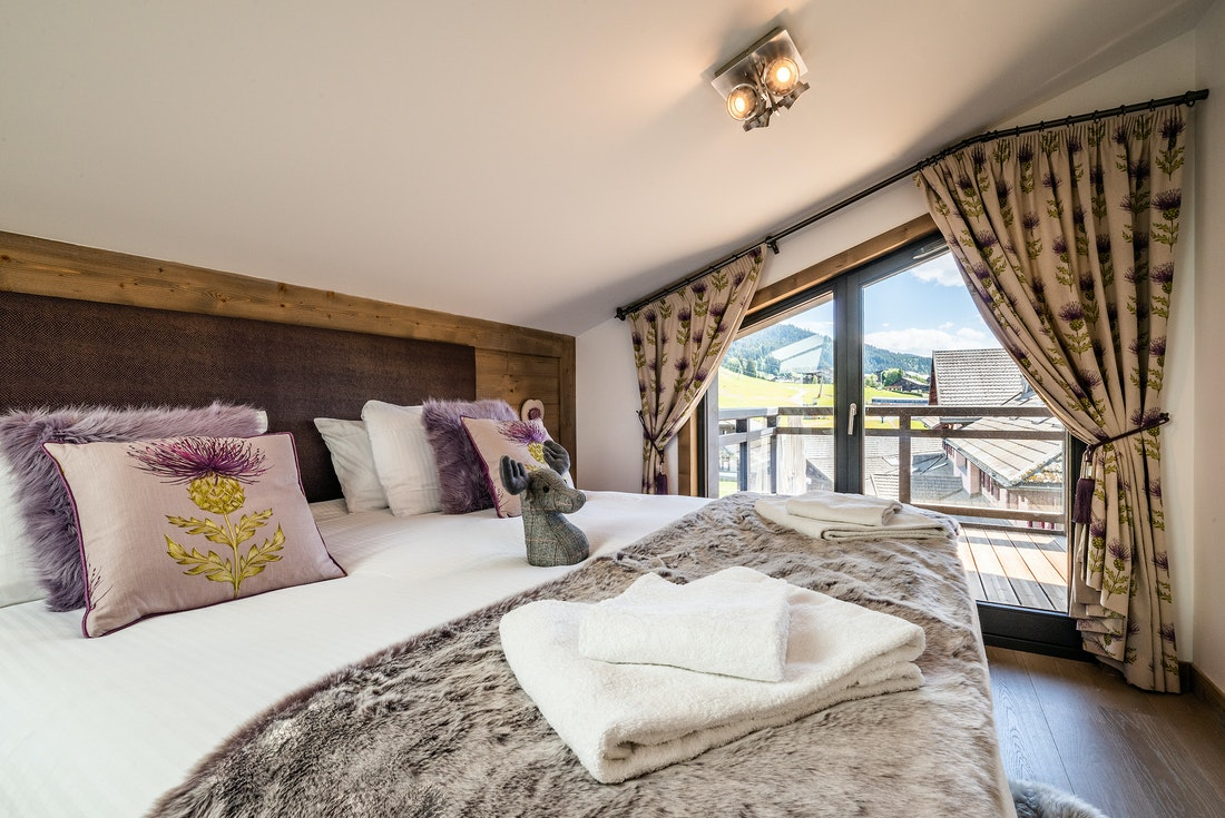 Ensuite Bedroom with fresh linen and towels at at Ozigo accommodation in Les Gets
