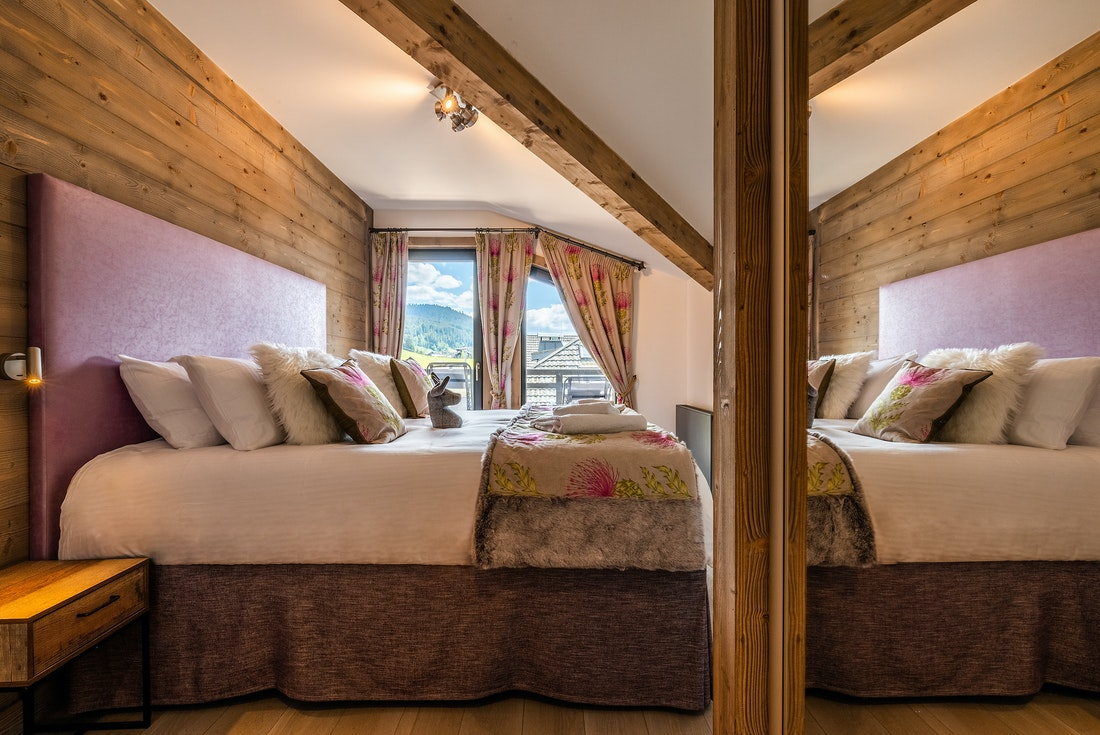 Ensuite Bedroom with wooden walls and mountain views at Ozigo accommodation in Les Gets