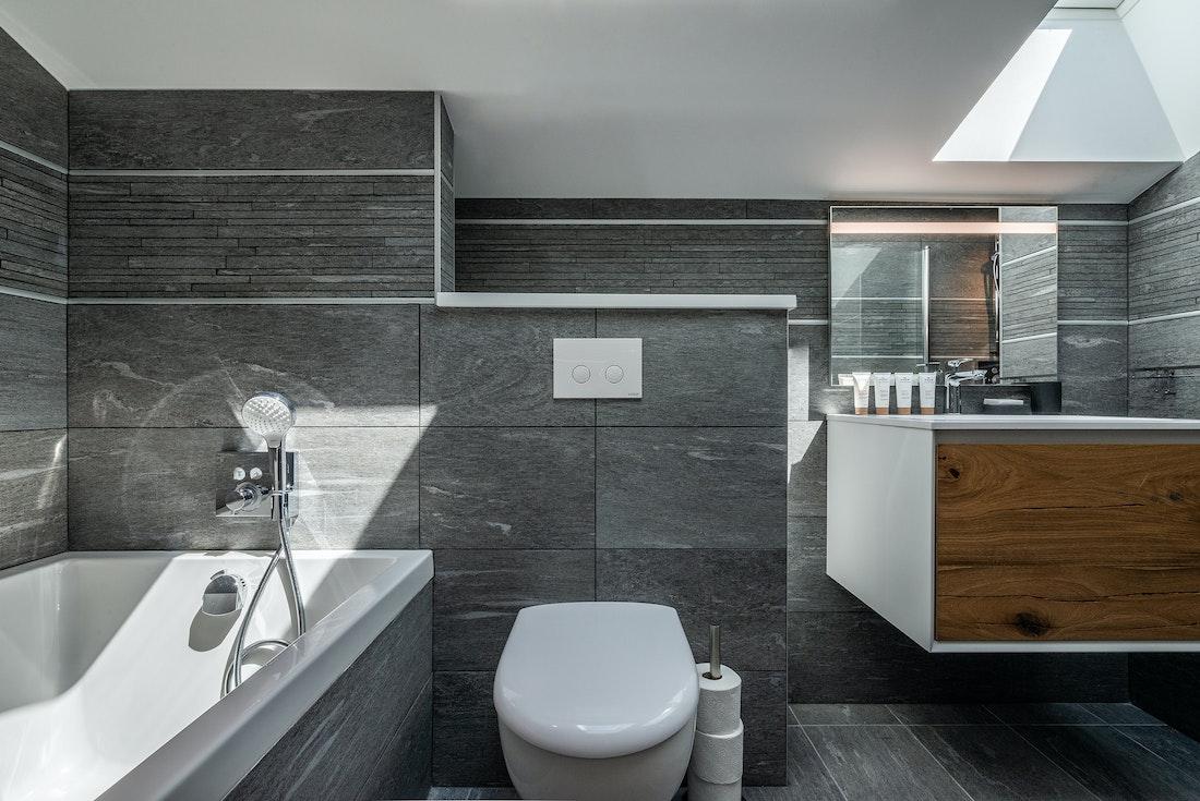 Modern grey bathroom with bathtub at Ozigo accommodation in Les Gets