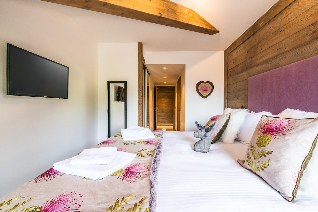 Ensuite Bedroom with fresh towels and television at Ozigo accommodation in Les Gets